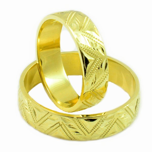 Svadobné obrúčky zo žltého zlata s ručným gravírom